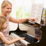 Woman-teach-girl-to-play-piano-2